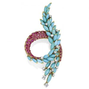 Marchak Swirl Turquoise and Ruby Brooch. Photo Courtesy of Christie's.
