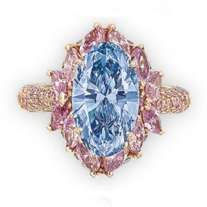 Moussaieff Vivid Blue Oval-Cut Diamond with Pink Diamond Surround.