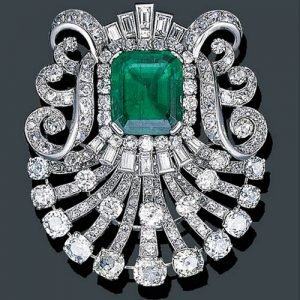 Mauboussin Art Deco Diamond Brooch with Colombian Emerald Center, circa 1925. Photo Courtesy of Christie's.