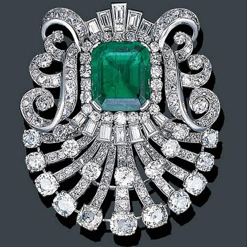 Mauboussin Art Deco Diamond Brooch with Colombian Emerald Center, circa 1925. Photo Courtesy of Christie's.