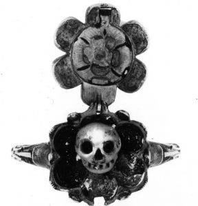 A Memento Mori Ring With A Diamond Flower Top Opening to Reveal an Enameled Skull c.1600s. © The Trustees of the British Museum.