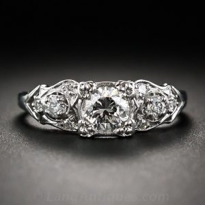1940s-50s Scroll Motif Diamond Engagement Ring.