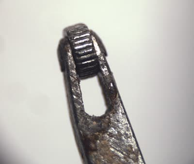Close-Up of a Millegrain Tool's Tip that will Leave a Jagged Pattern.