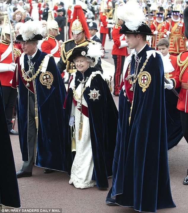 The Queen, Prince Charles and Prince William in their Order of the Garter Regaila. Photo Courtesy of the Daily Mail.
