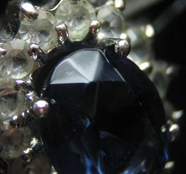 Example of a Paste Sapphire Imitation. Notice the Rounded Facet Edges Which Tell Us the Stone Wasn't Cut, but Cast into a Model. Photo by JB.