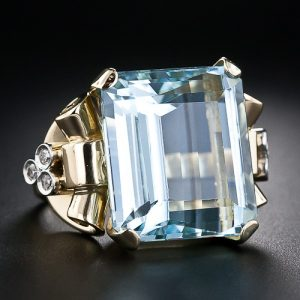 Retro 22 Carat Aquamarine Ring with Scroll Motif Mount.