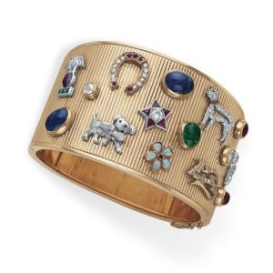 Retro Cuff Bracelet Enhanced by Applied Charms and Stickpins c.1945.