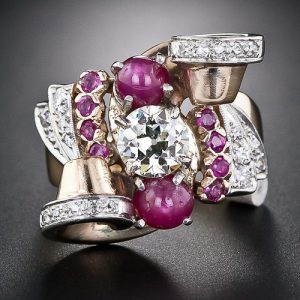 Retro Ruby and Diamond Ring with Scroll and Fan Motif Accents.