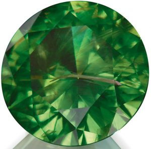Russian Demantoid Garnet with Horsetail Inclusion. Photo Courtesy of Constantin Wild.