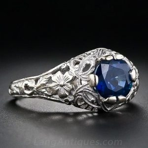 Royal-Blue Sapphire in a Floral Motif Edwardian Mount.