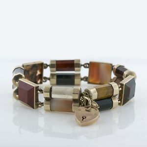 This is a Unique 14 Karat Yellow Gold Dimensional Double Row Scottish Bracelet with a Heart Shaped Safety. Included are Varieties of Jasper, Moss Agate, Banded Agate and Cairngorm.