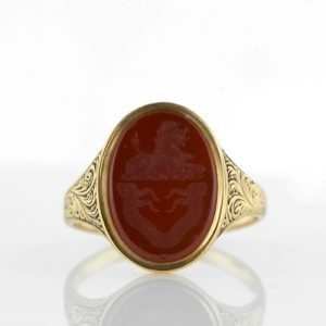 Signet Ring with Reddish Orange Carnelian Intaglio of a Regal Lion with Scroll Motif Shoulders, Mid Victorian.
