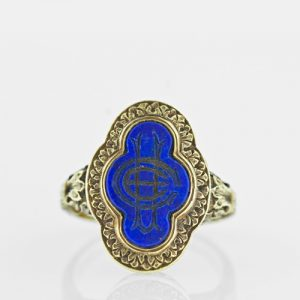 Signet Ring with Neo-Classical Motifs, a Quatrefoil-Shaped Lapis Lazuli and a Cryptic Insignia.