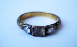 A c.17th Century Mourning Ring with a Gold Cipher Capped by Rock Crystal with Traces of Black Enamel. © The Trustees of the British Museum.