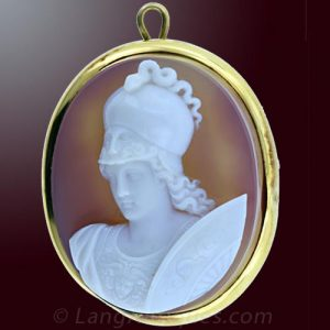 Hardstone Cameo Depicting Athena Wearing a Helmet with a Live Serpent on Top and a Secondary Visage on the Visor. Her Chest Armor Displays the Aegis of Zeus.