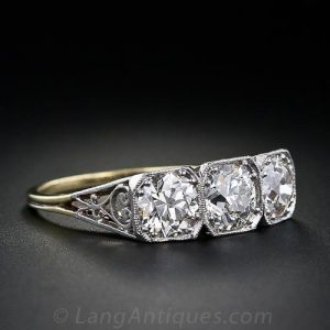 Edwardian Diamond Three-Stone Engagement Ring with Scrolled Gallery.