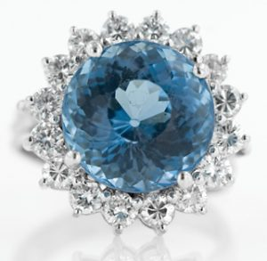 A White Golden Entourage Ring Set with Diamonds and Deep Blue Chrysanthemum Cut Topaz.