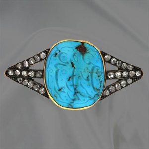 Carved Oval Turquoise with Arabic Characters Set In a Victorian Brooch.