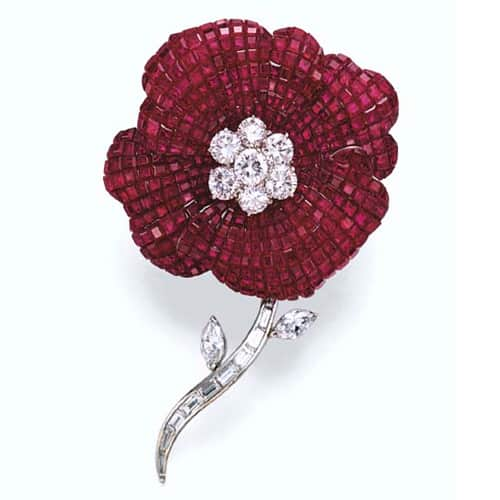 "Van Cleef & Arpels Serti Mysterieux Ruby and Diamond ""Millennium"" Brooch, 2000. Photo Courtesy of Christie's."