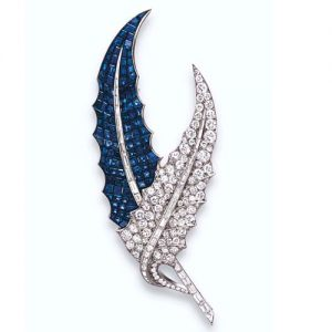 Van Cleef & Arpels Serti Mysterieux Diamond and Sapphire Leaf Brooch, c.1939. Photo Courtesy of Christie's.