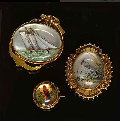Victorian Reverse Crystal Intaglio Brooch Collection Depicting a Ship and Two Birds. Photo Courtesy of Bonhams.