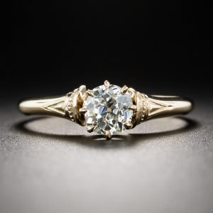 TVictorian Solitaire Mine-Cut Diamond and 14k Yellow Gold Engagement Ring.