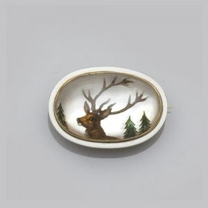 Reverse Crystal Intaglio Depicting a Deer and Framed in White Enamel. Photo Courtesy of Bonhams.
