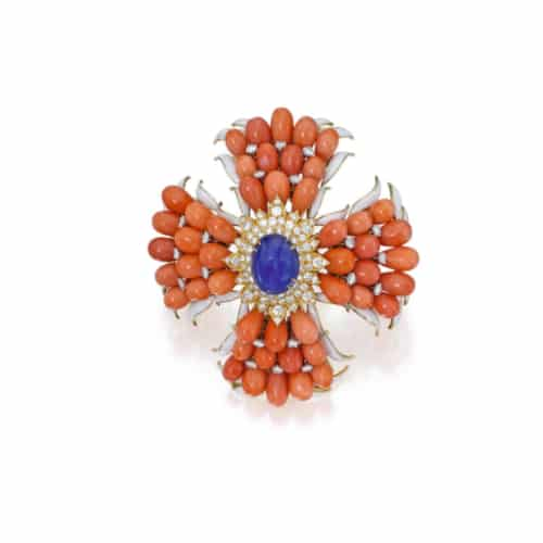 Webb Coral, Sapphire and White Enamel Pendant Brooch. Photo Courtesy of Sotheby's.