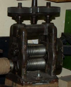 A Rolling Mill Featuring Combination Rolls to Make Gold Wire.
