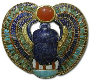 Stunning inlay of precious stones in cloissons of gold. A winged scarab made of lapis lazulli, malachite, turqoise and a carnelian sun.