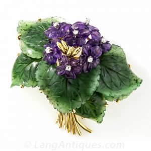 Carved Nephrite and Amethyst Floral Brooch .