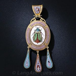 Ancient Egyptian Revival style pendant necklace featuring an iridescent scarab that has alighted smack in the center of an intricately designed and executed micro-mosaic cartouche