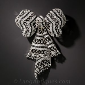 Edwardian Diamond, Onyx and Platinum Bow Knot Brooch.