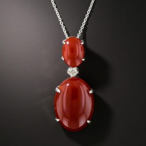 Opaque Red Coral and Diamond Pendant.