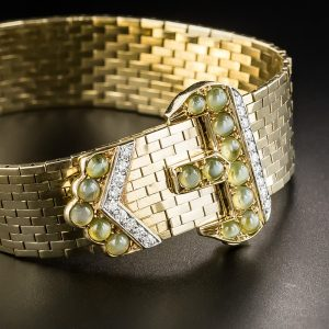 Retro Jarretière with Buckle and Mordant Accented by Chrysoberyl and Diamonds.