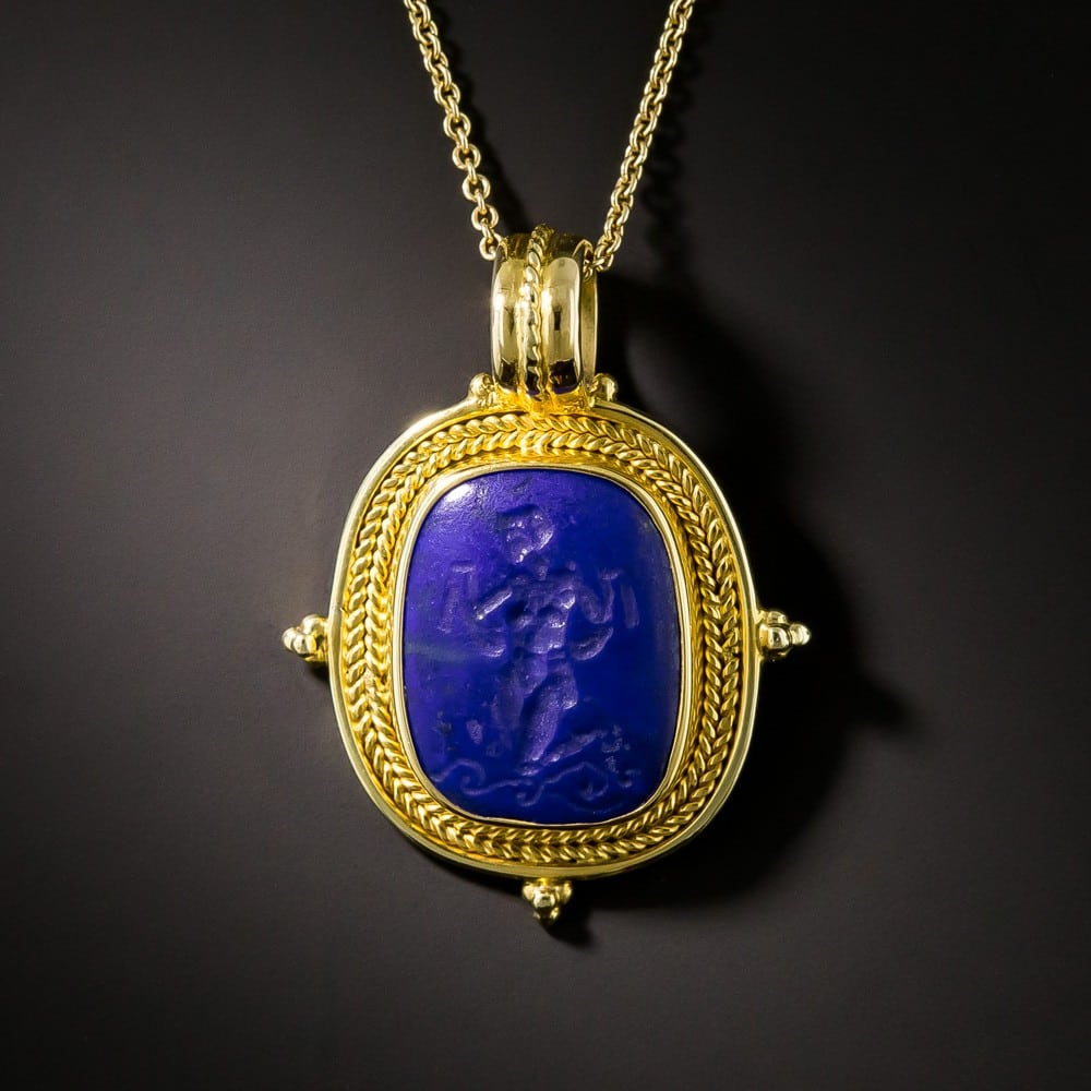 Archeological Revival Carved Lapis Lazuli and Gold Pendant.