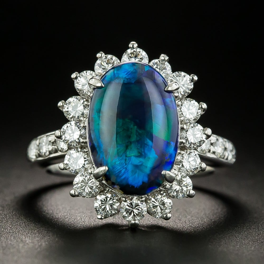 Black Opal Ring with and Entourage of Diamonds.