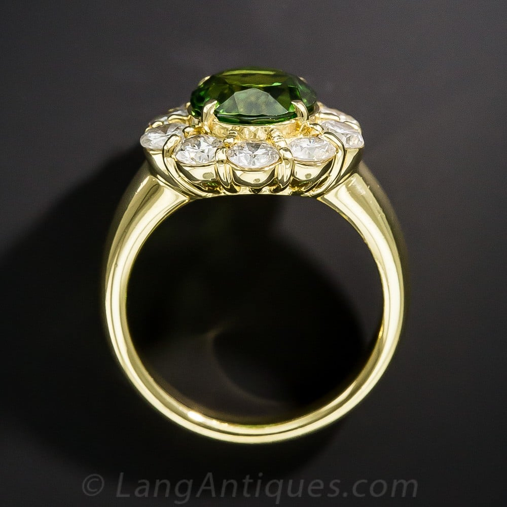 Green Tourmaline and Diamond Halo Ring. The Tourmaline Color is a More Olive Green from this Crystal Direction - Exhibiting Pleochroism.