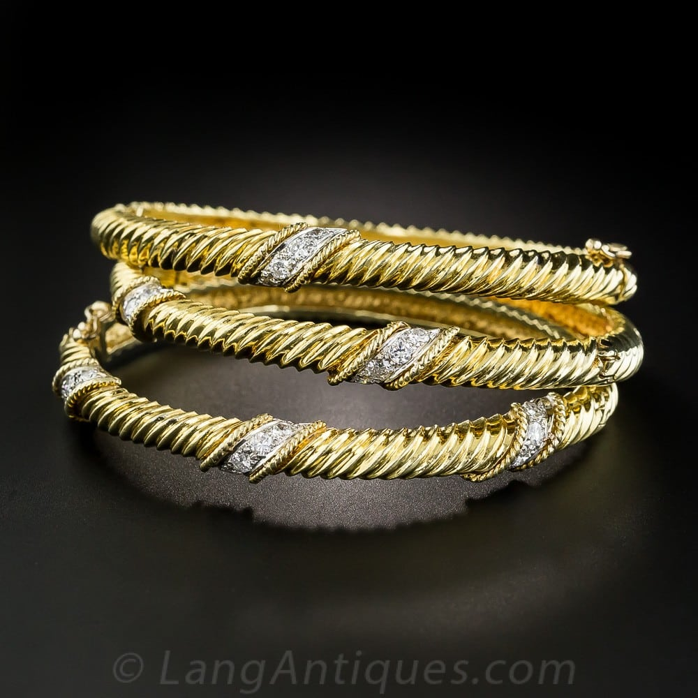 Collection of Three Diamond and Yellow Gold Bangle Bracelets.