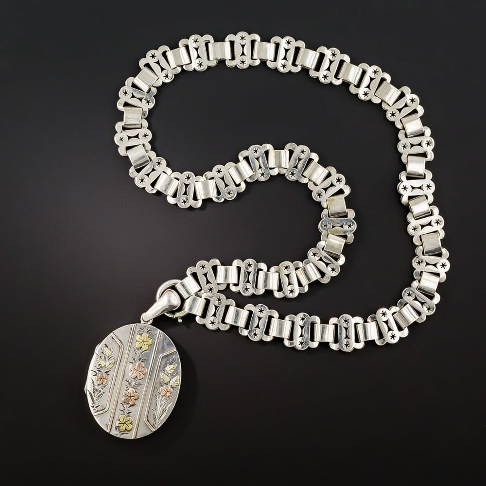 Victorian Silver Floral Locket Suspended from a Book Chain.