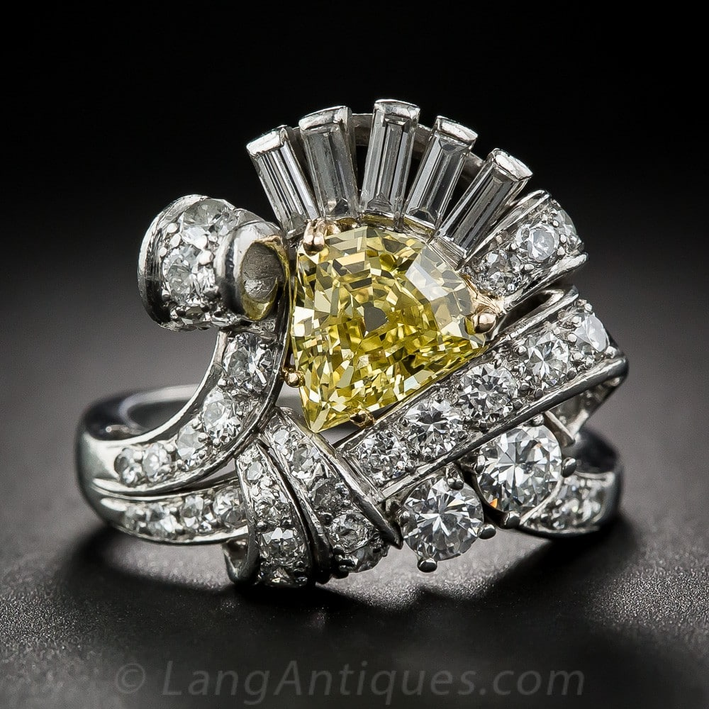 Shield-Shaped Intense Fancy Yellow Diamond, Platinum, and Diamond Cocktail Ring.