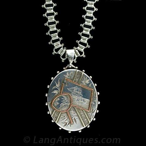Antique Silver Locket is Etched with a Maritime and Fauna Motif in a Japonesque Style.