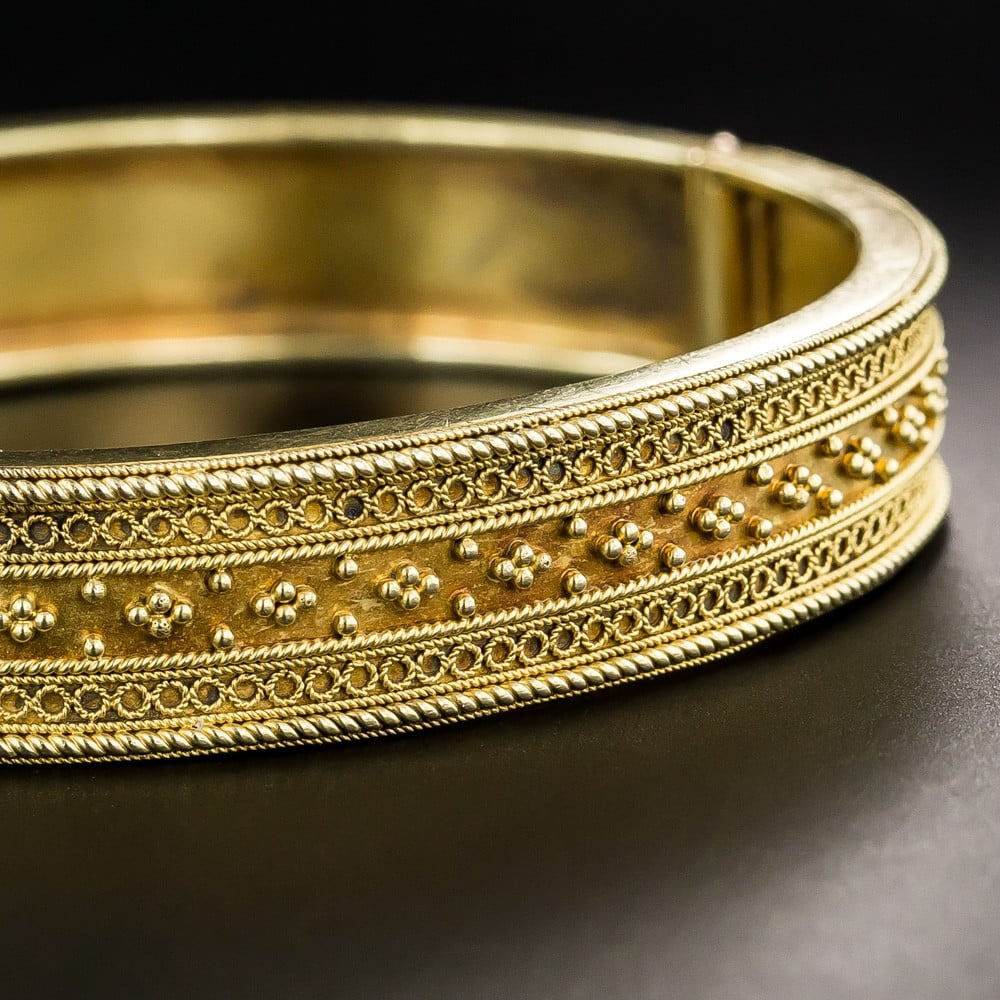 Victorian Etruscan Revival Bangle Bracelet with Granulation and Wirework Design Elements.