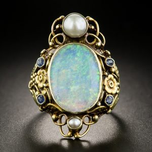 Arts & Crafts Opal, Sapphire, and Pearl Dinner Ring.