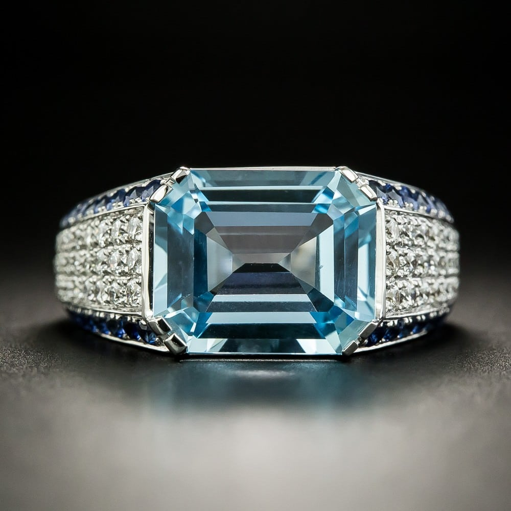 Blue Topaz, Diamond, and Sapphire Ring.