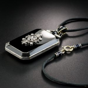 Edwardian/Art Deco Diamond and Black Enamel Locket Suspended from a Cord.