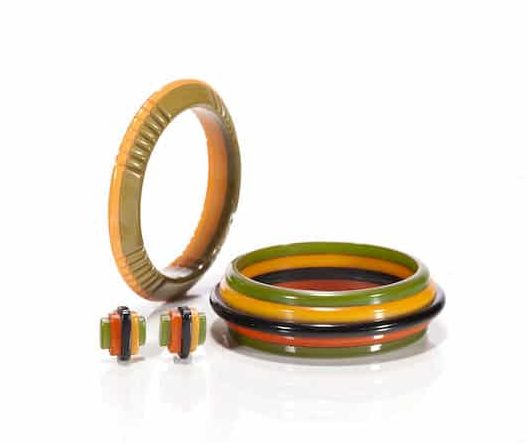 Bakelite Multi-Colored Bangle Bracelets and Earclips. Photo Courtesy of Bonhams.